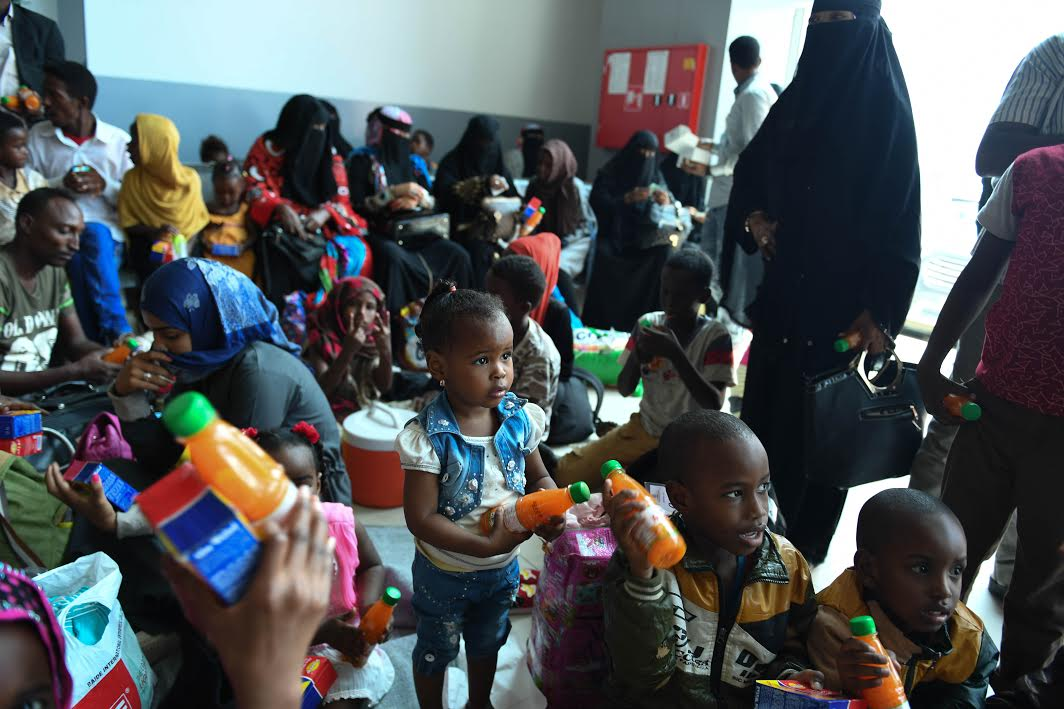 Somali nationals accompanied by their children rest at Aden Abdulle International Airport terminal in Mogadishu upon returning from Yemen on February 23, 2017.  At least 106 Somali nationals arrived on the flight organized by the International Organization for Migration. UN Photo / Ilyas Ahmed