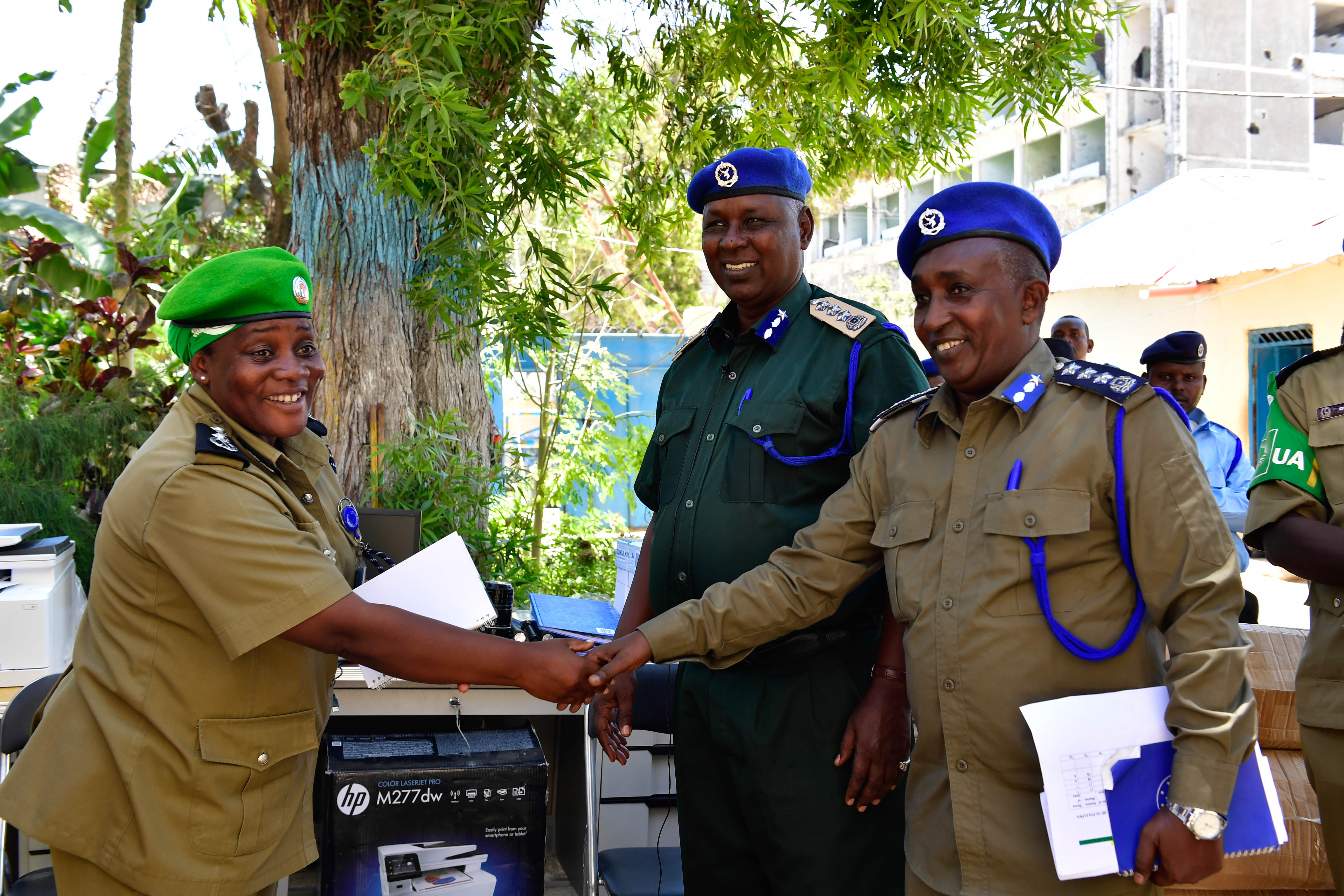 Christine Alalo, the Deputy Police Commissioner of the African Union Mission in Somalia (AMISOM) hands over office equipment donated by AMISOM to the Somali Police Force in Mogadishu, Somalia on September 18, 2017. AMISOM Photo / Mohamed Haji